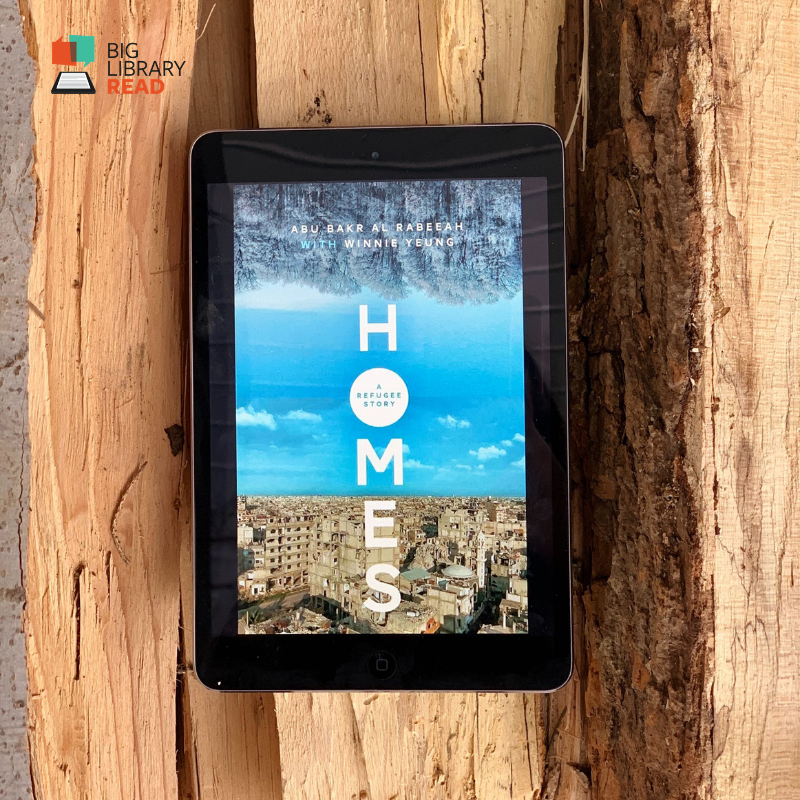 Tablet with book cover for Homes displayed on it.