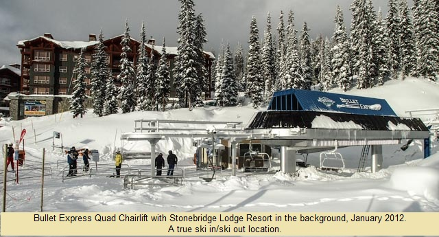 Bullet Express Quad Chairlift with Stonebridge Lodge Resort in the backgrouned. A true ski in/ski out location