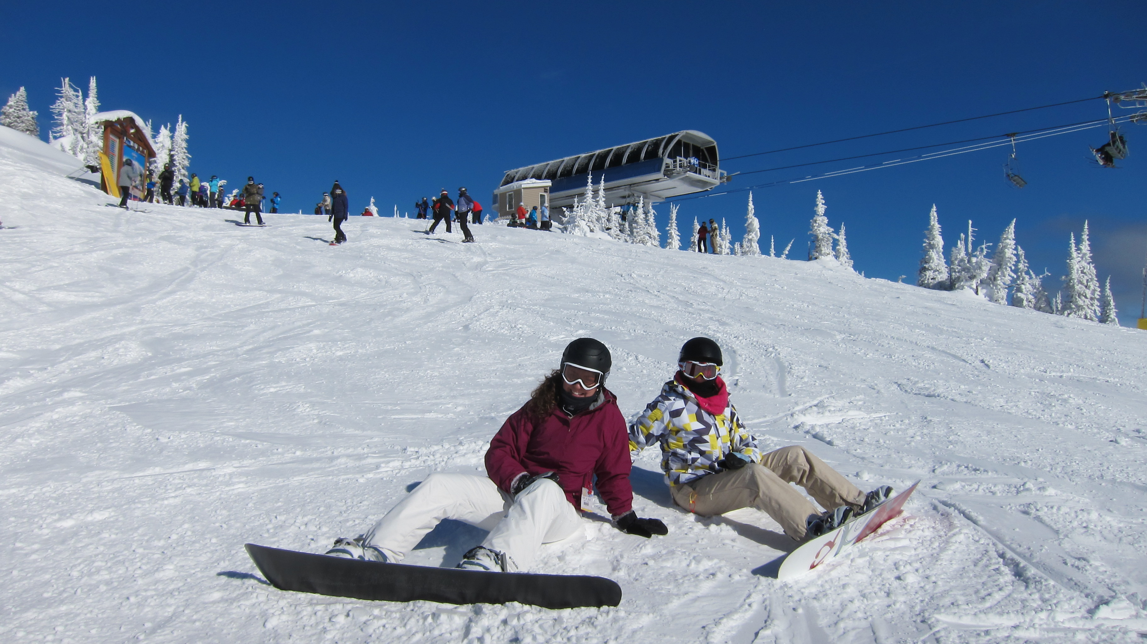 Snowboarders take a break at the Black Forest Chairlift