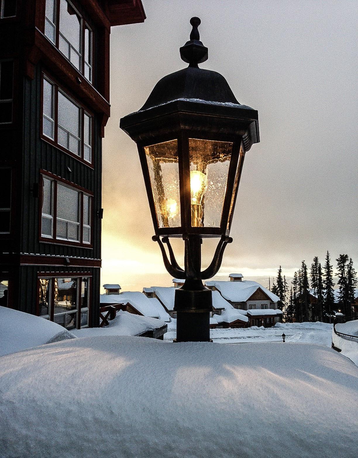 snow accumulates around the lamps at Stonebridge Lodge