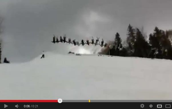 30 People Skiers Hold Hands And Pull Off A Backflip At The Same Time
