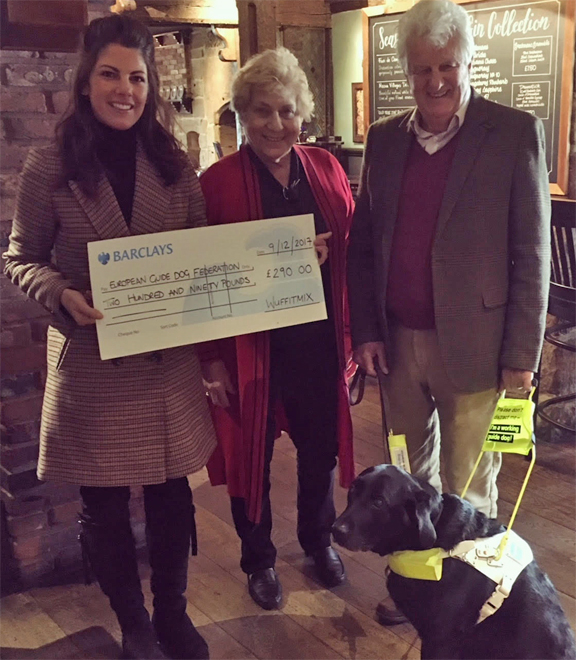 Hannah Dugdale presents cheque for £290 to EGDF Executive Director Judith Jones, President David Adams and his guide dog Zoey