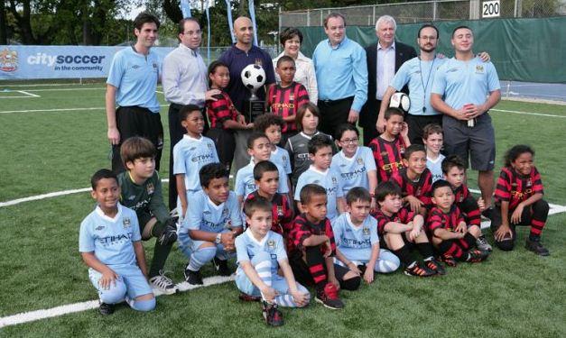 "Ambassador Yousef Al Otaiba Visits attends a ""City Soccer in the Community"" field dedication"