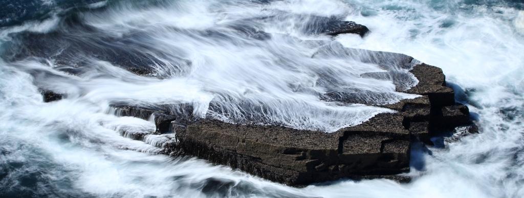 Sea washing over rocks in Orkney