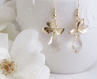 Gold orchid flower with faceted crystal earrings