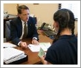 Director of Financial Aid Greg Becher meets with a student