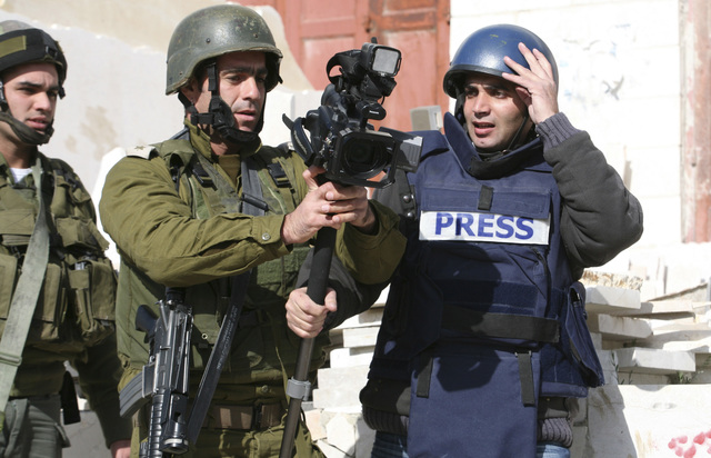 israeli soldier accosts reuters cameraman