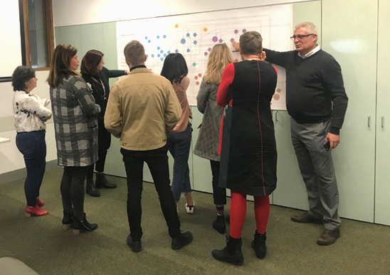 A group of people discussing the map at a consultation