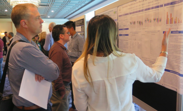 Above, Dr. Sean Dukelow, left, at the poster session at the 2018 Annual Scientific Meeting.