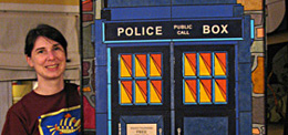 "Artist Choleena DiTullio with ""Police Call Box"" paper-tile artwork"