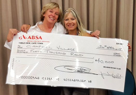 Josie (Melkbos Rotary) handing cheque to Janine (Camphill Fundraiser)