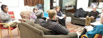 group of people sitting around talking