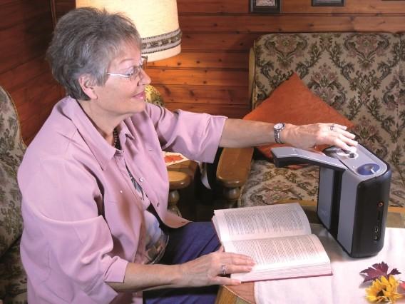 A lady using Eye-Pal Reader- Image