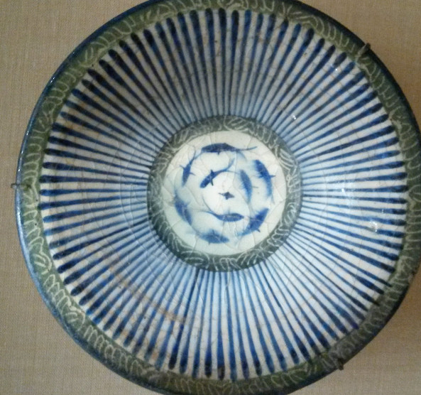 Iranian bowl with psudoinscriptions and fish