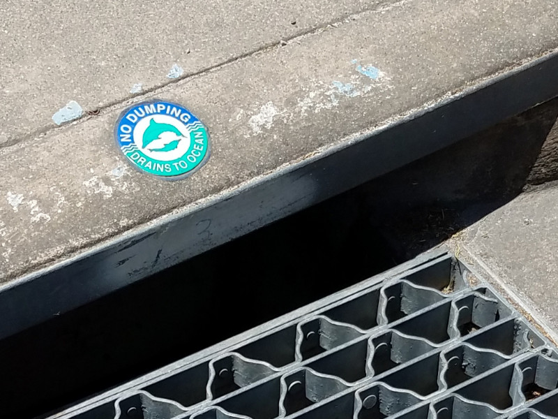 Storm inlet with Drains to Ocean marker