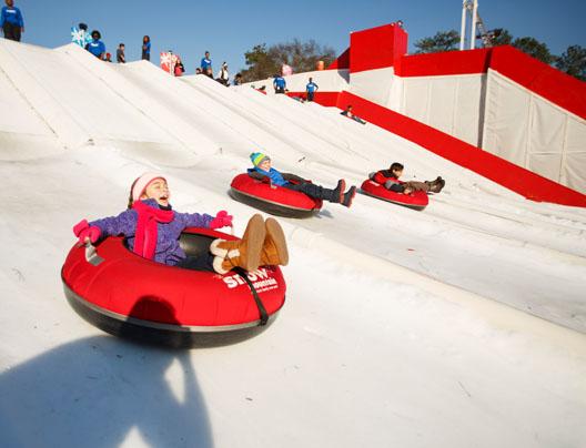 Kids sliding down Snow Mountain