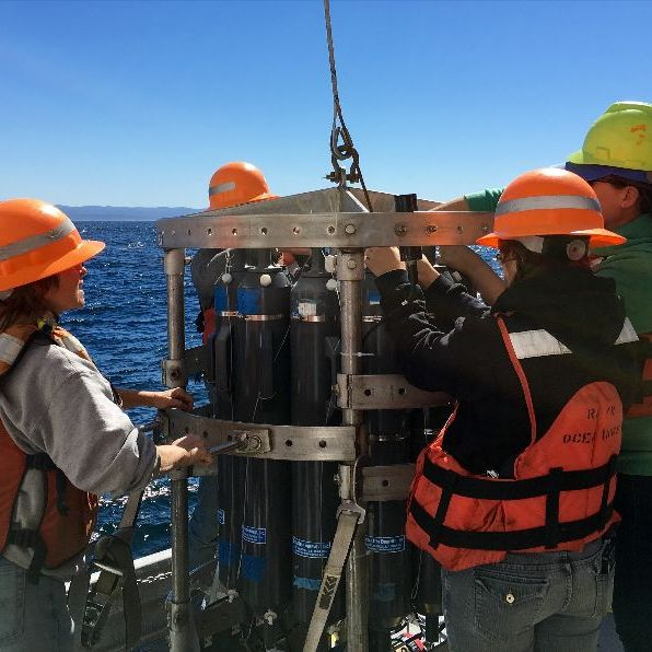 high school educators and students launch a CTD from the deck of the R/V Oceanus