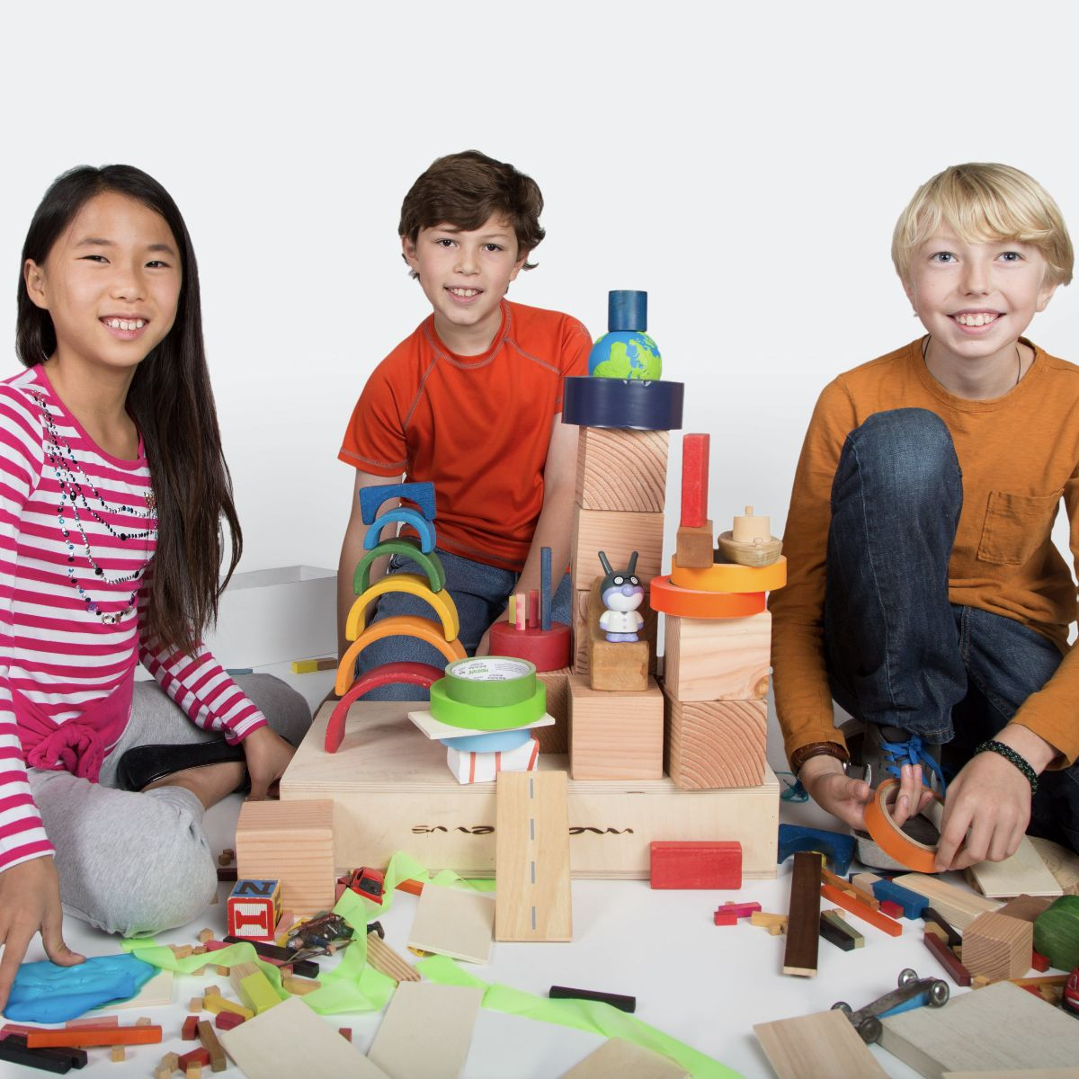Three students pose with their model building materials. Photo: DiscoverE