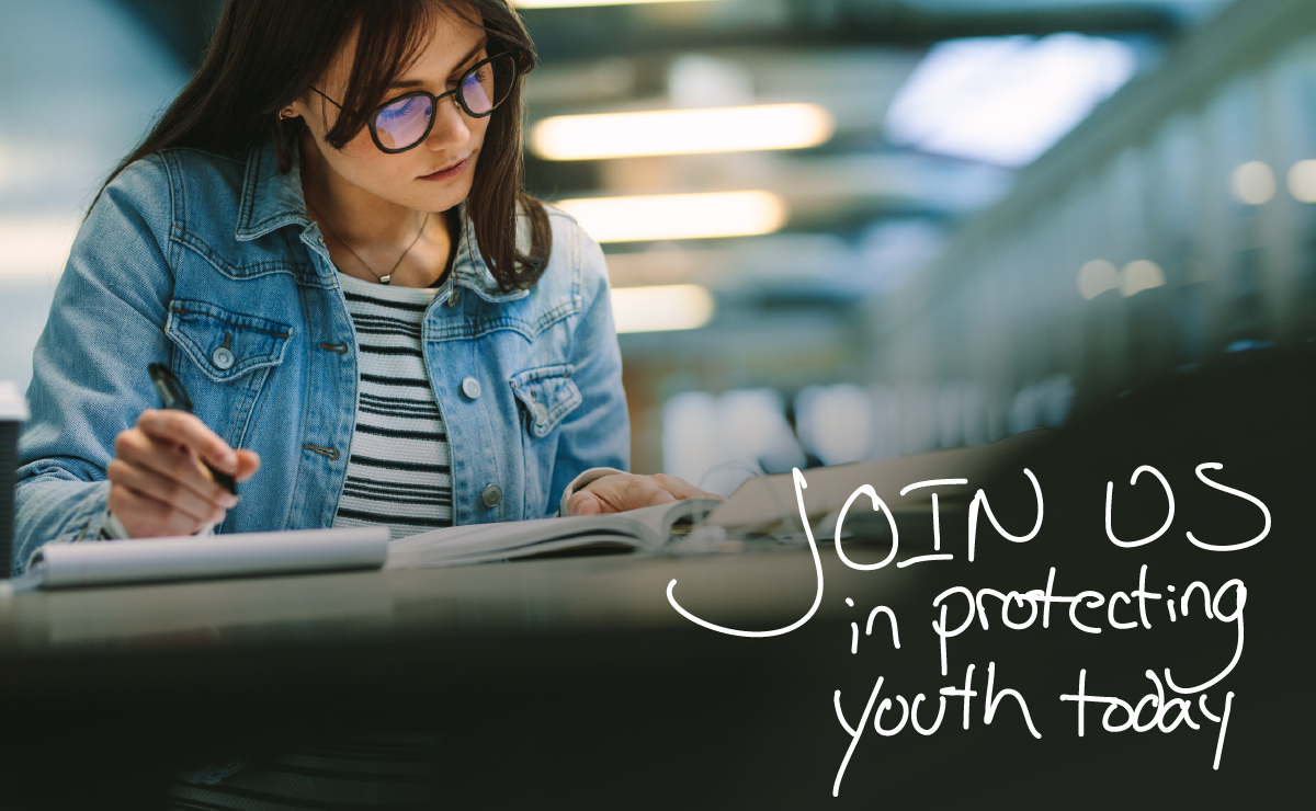 """Student studying with """"Join us in protecting youth today"""" written on top of image"""