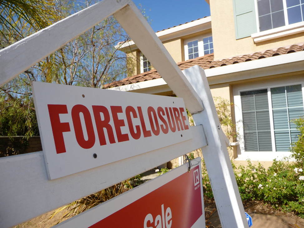 House with Foreclosure sign in front