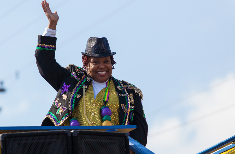 Float rider in the Krewe of Harambee Martin Luther King Jr. Day Mardi Gras Parade
