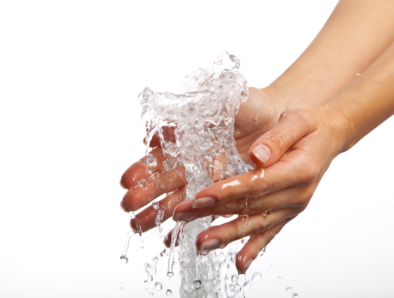 Image of two hands being washed with water