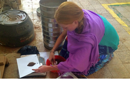 student weighs soil sample