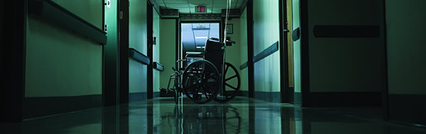 Emtpy Wheelchair in a Hallway