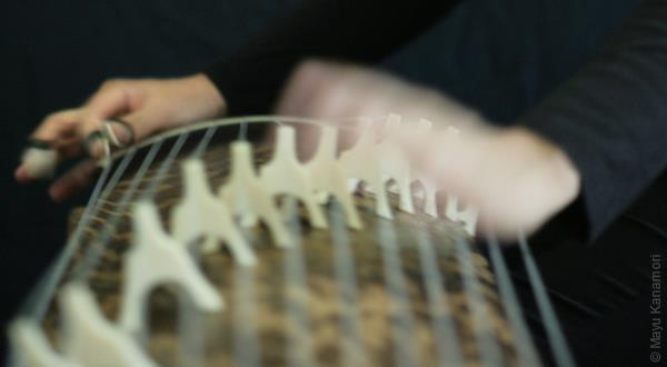 Hands playing koto