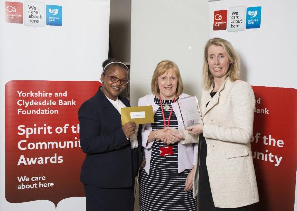 Helen and Twimukye receiving award