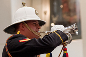 A bugler plays the Last Post during a remembrance ceremony
