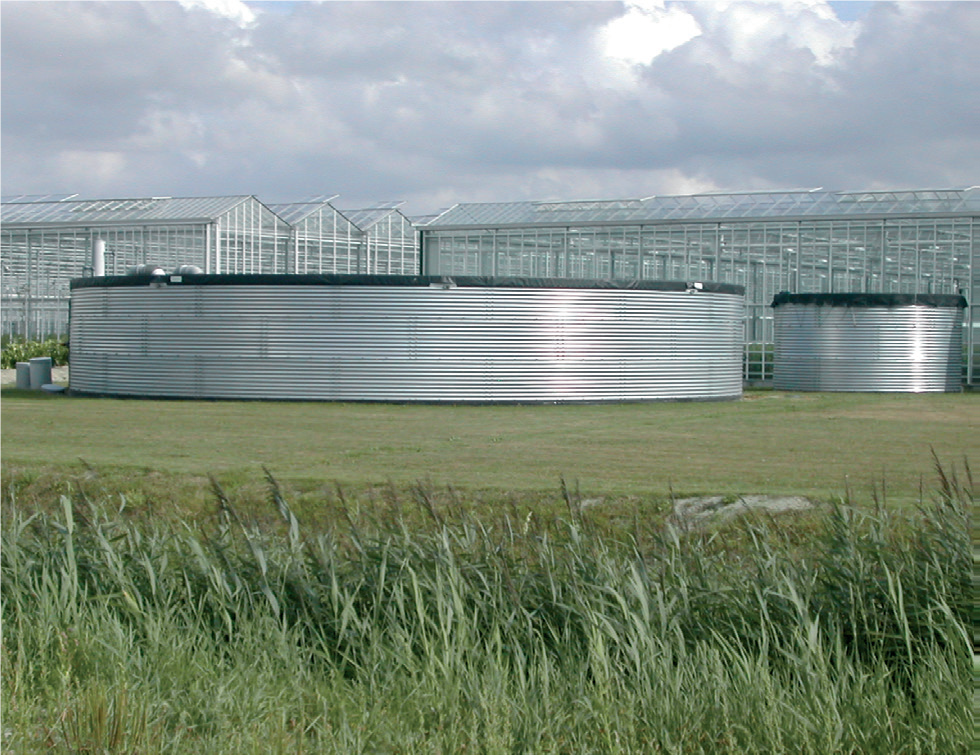 Watertank in front of greenhouse