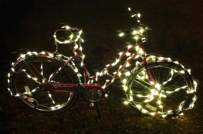 Bicycle wrapped in Christmas lights at Hometown Bicycles