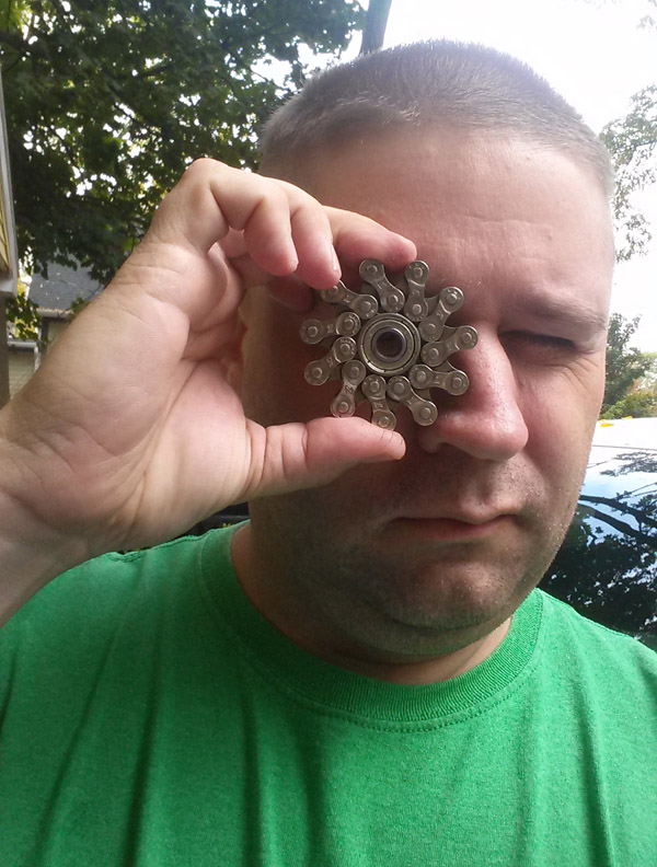 Jason Crandall with his bike chain fidget spinner, now available at Hometown Bicycles