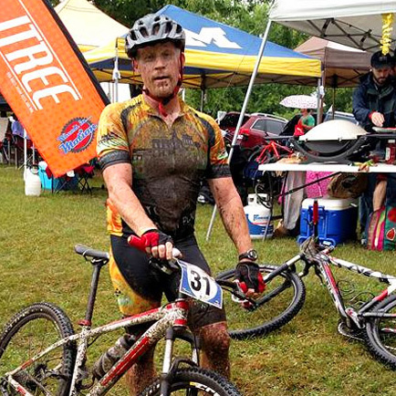 Team Hometown Bicycles Captain Jim Cleer muddy from mountain biking