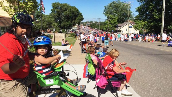 Shaun Bhajan of Hometown Bicycles in the Downtown Brighton's Fourth of July Parade with the Brighton Optimist Club