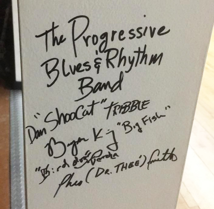 "The Progressive Blues & Rhythm Band signatures on the ""I Support Hometown"" posts at Hometown Bicycles"