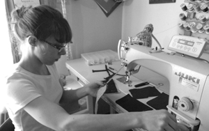 Artist Lauren Patrell of LPbyLP crafting her exquisite bags and purses with repurposed fabrics
