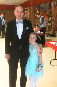 Hometown Bicycles Team member Scooter Gate with daughter at SELCRA's Brighton Daddy-Daughter Dance