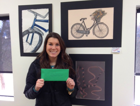 Ellen Bartush and her artwork that sold at Hometown Bicycles