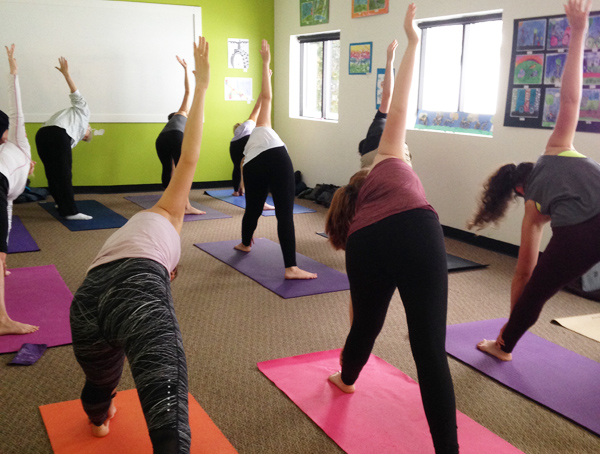 Vinyasa Yoga class at Hometown Bicycles in Brighton with Ashley Knuth of Tocca Massage and Yoga