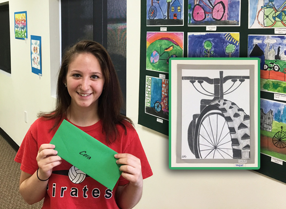 Cora Kroll of Pinckney High School with her sold bicycle art at Hometown Bicycles
