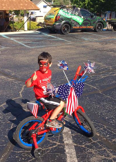 Bradley on his 4th of July parade bicycle with Brighton Optimist Club and Hometown Bicycles
