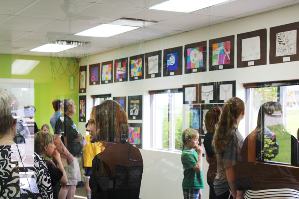 South Lyon's Barlett Elementary School 5th Grade student artists are celebrated at Hometown Bicycles student art open house