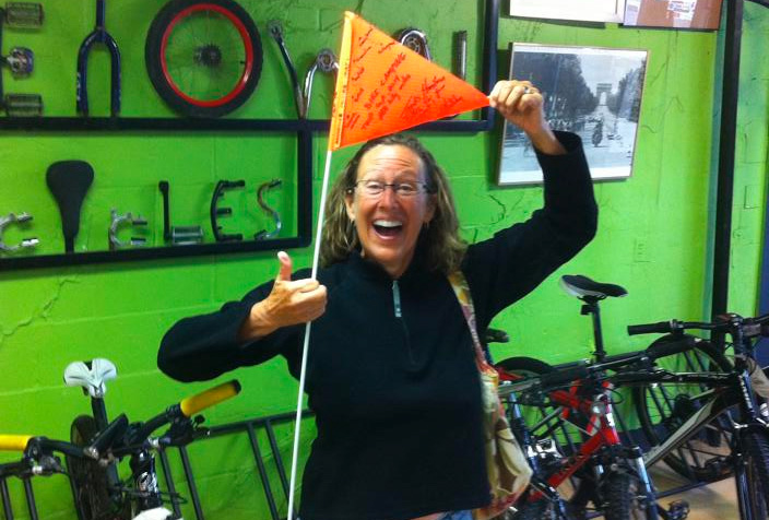 Gretchen Klatt at Hometown Bicycles after her cycling adventure!