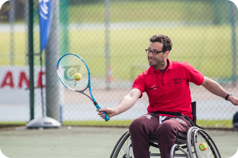 Man in wheelchair playing tennis