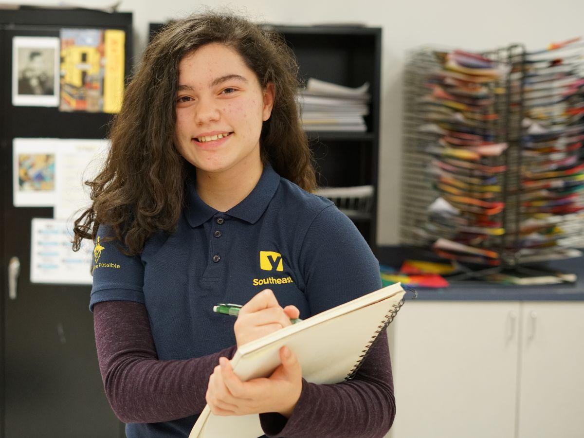 Daniella Diaz posing in art classroom