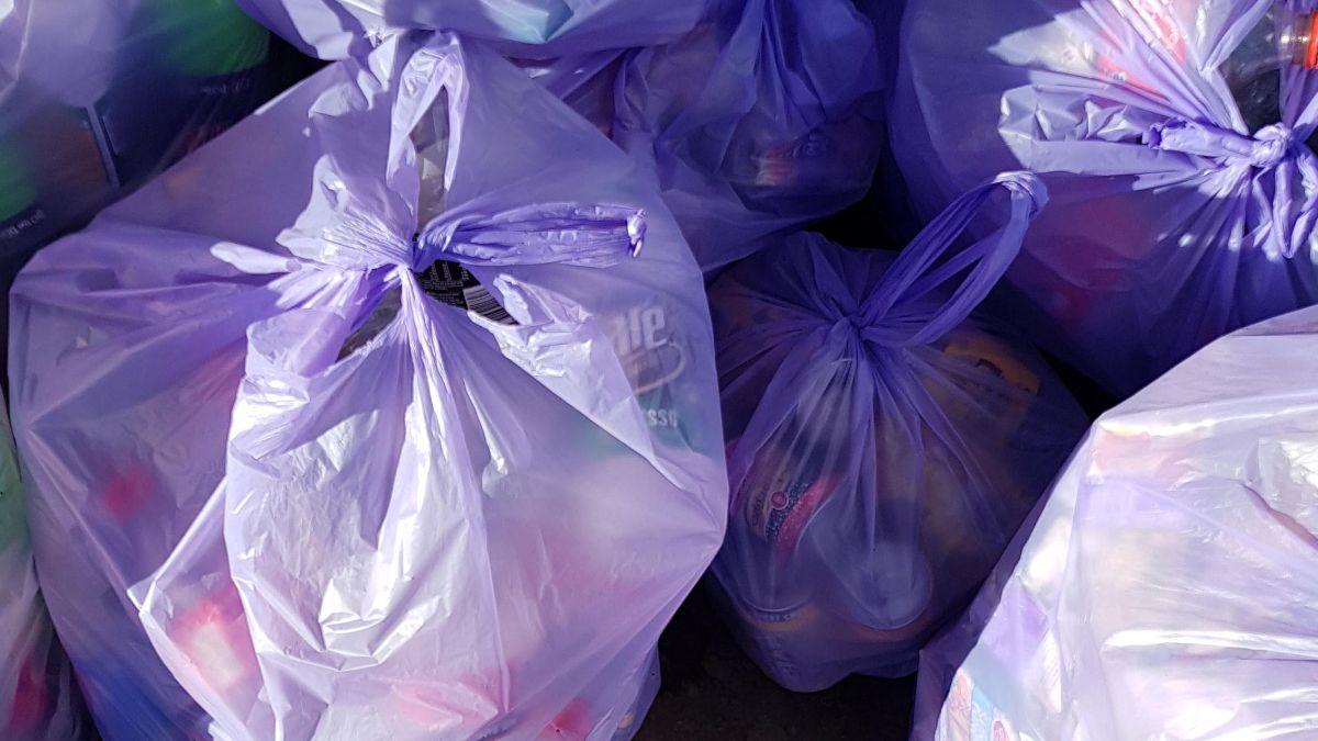 A pile of full violet trash bags