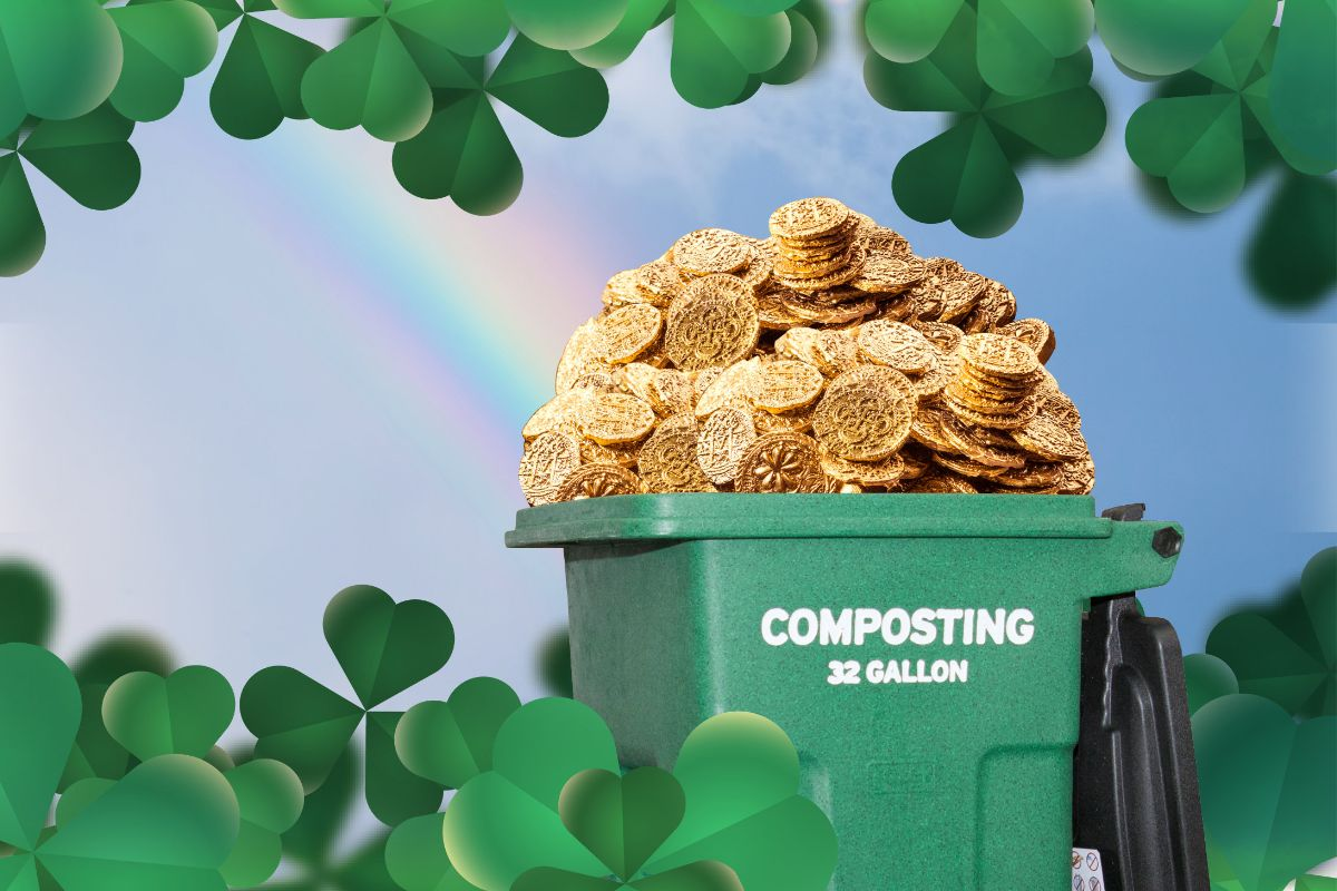 Green compost cart with gold coins inside and rainbow leading to it