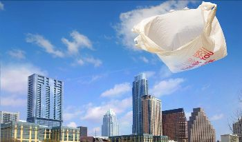 Plastic bag blowing in the wind with Austin skyline